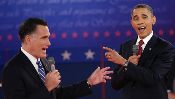 Mitt Romney and Barack Obama talk over each other as