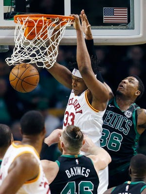 Indiana Pacers' Myles Turner (33) dunks in front of Boston Celtics' Marcus Smart (36) during the first quarter of an NBA basketball game in Boston, Sunday, March 11, 2018.