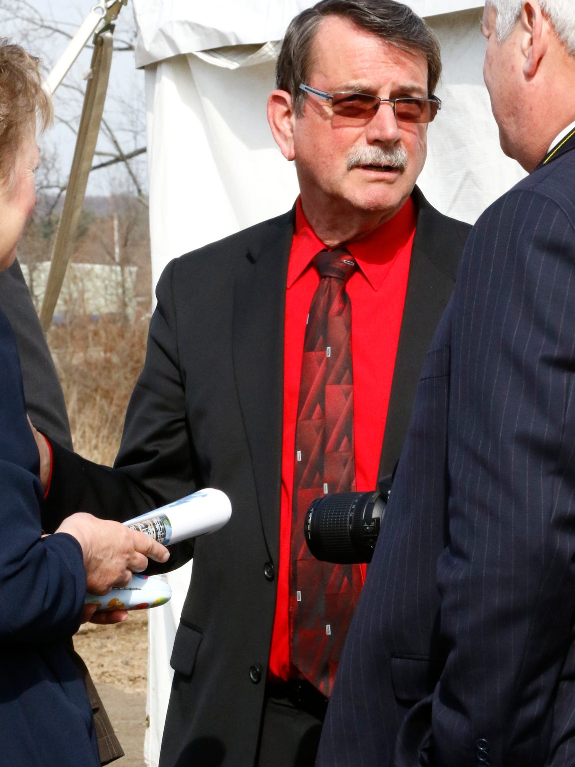 Wausau Mayor Jim Tipple mingles Monday morning, April 18, 2016, during a groundbreaking ceremony of the north riverfront development in Wausau.