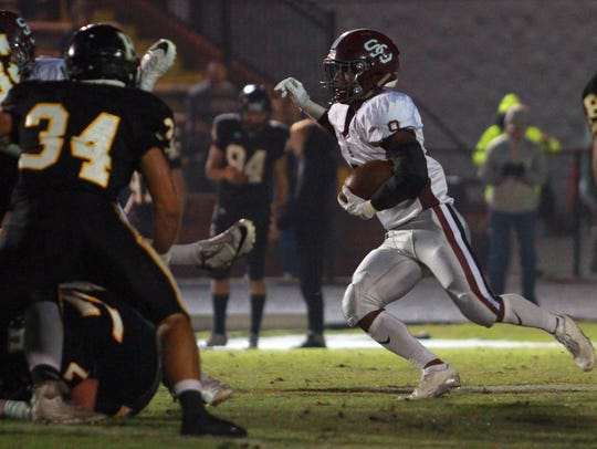 Station Camp's Sirtavious Perry rushes against Hendersonville