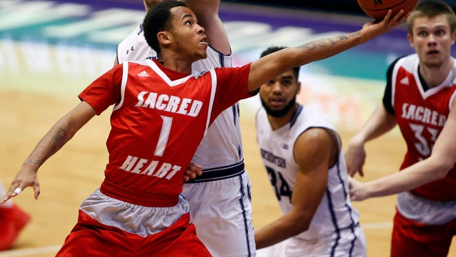 Sacred Heart Pioneers guard Cane Broome (1) goes to the basket against the Northwestern Wildcats at Welsh-Ryan Arena in December.