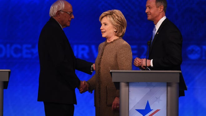 Bernie Sanders, Hillary Clinton and Martin O'Malley appear on stage at a Democratic debate in Manchester, N.H., on Dec. 19, 2015.