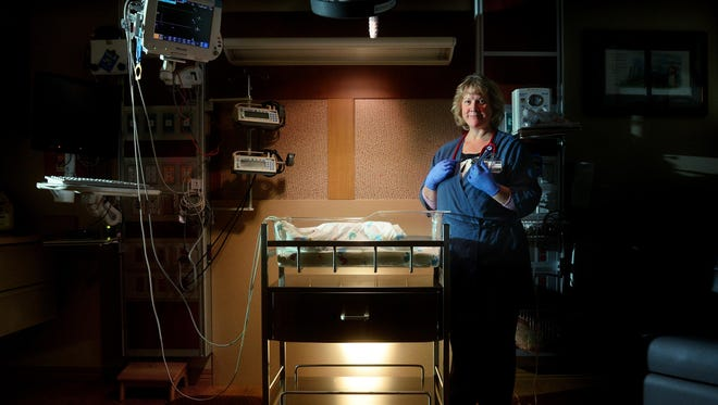 Janine Hester, neonatal nurse practitioner in the Benefis NICU, poses in a NICU room at the hospital Thursday morning.