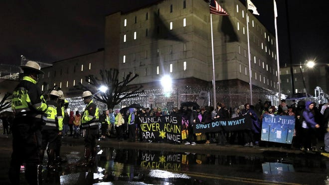 Central Falls, RI, Dec 10, 2019 - Never Again Action protesters line the sidewalk across from the Wyatt Detention Center on Tuesday evening along with members of the RI State police on the scene.  Protest at the Wyatt Detention Center featuring stations focused on Latino and Jewish cultures on Tuesday evening.