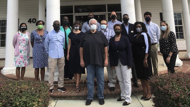 The  Richmond Hill and Bryan County Cultural and Diversity Task Force recently posed for its first group photo in front of Richmond Hill City Hall as a diverse portrait of community leaders. Though clad in protective masks, a sign of the times, they are looking ahead to the future - one where everyone has a seat at the table.