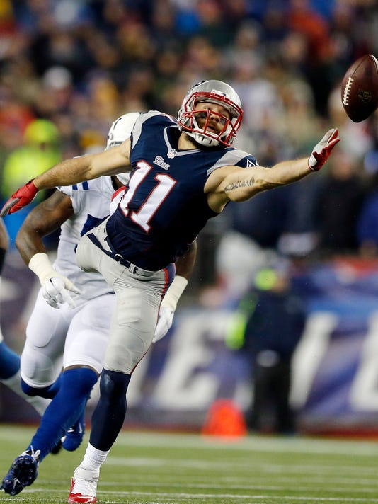 New England Patriots wide receiver Julian Edelman (11) cannot make the catch on a pass from Tom Brady during the first half of the NFL football AFC Championship game against the Indianapolis Colts Sunday, Jan. 18, 2015, in Foxborough, Mass. (AP Photo/Julio Cortez)