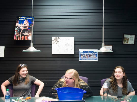 From left, Kendall Condra, Rosie Young, and Brianna O'Dell take a break from rehearsing for CTE Goes Live at Stellar Vision and Sound on Tuesday, May 2, 2017.
