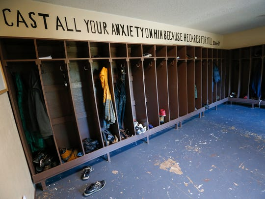 "The message ""Cast all your anxiety on Him because He cares for you."" is written on the wall above where boys at Lives Under Construction Boys Ranch hang their jackets."