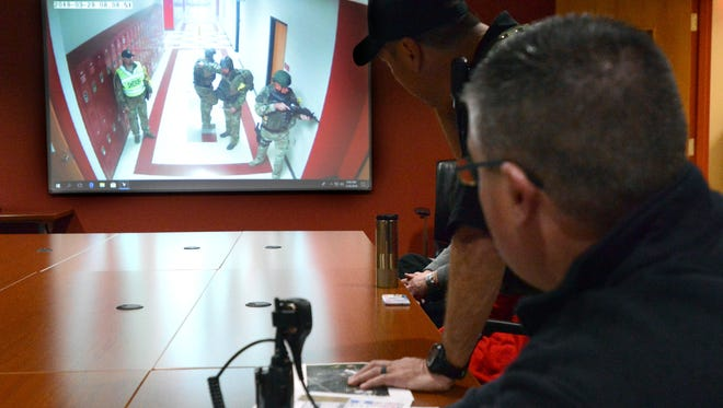 Fairifled County Sheriff's Office SWAT team commander Sgt. Jared Collins, left, and Richland Township Fire Department Battalion Chief Scott Baker watch a video feed of SWAT team members moving through the hallways of Fairfield Union High School during a training exercise Wednesday, March 28, 2018, in Rushville. More than 200 Fairfield Union faculty and staff members, FCSO officers and firefighters and medics from five county fire departments took part in the training exercise.