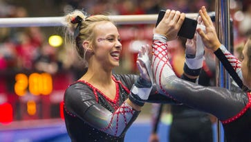 Memory Shettles celebrates a routine with her teammates.