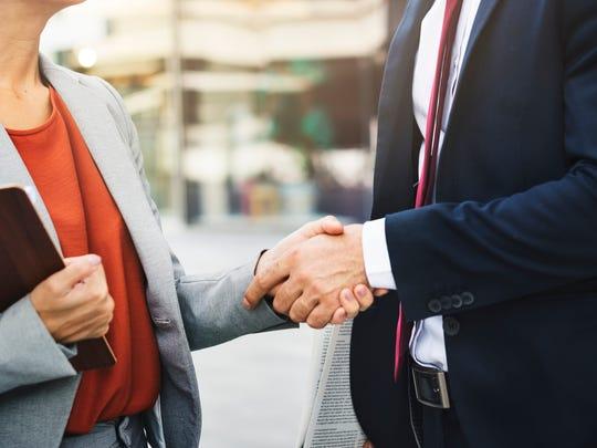 Men shouldn't dial back their handshake for women.