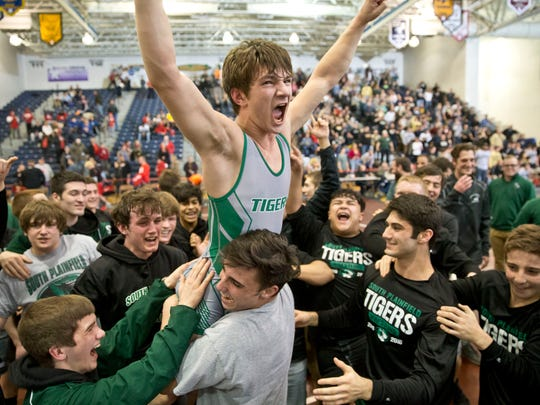 South Plainfield lifts Joe Sacco after winning. South Plainfield vs Delsea in NJSIAA Group III team wrestling finals.  
