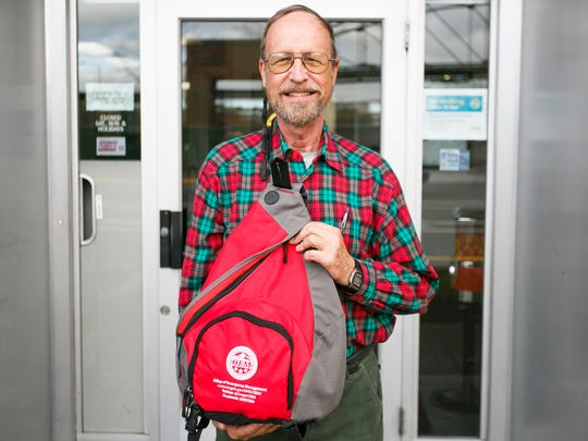 Jim Klein picks up his earthquake preparedness kit at the Statesman Journal on Wednesday, Nov. 9, 2016. Klein and his wife Marti have outfitted their cars with emergency kits as well.