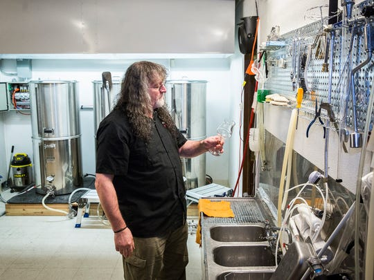 The Heorot brewer Bob Cox visits the bar's brewery Thursday night.