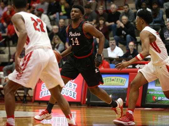 North Central Panthers Emmanuel Little (14) moves the ball during second half action between Pike and North Central in Marion County boys finals, at Southport High School, Indianapolis, Saturday, Jan. 14, 2017. Pike won, 71-64.