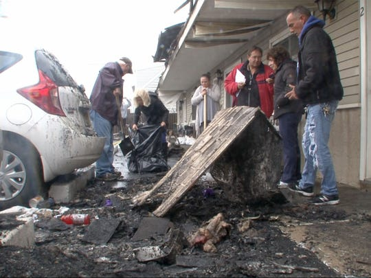 Owners begin the cleanup from an overnight fire in