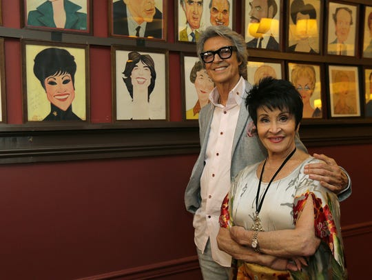 Tommy Tune and Chita Rivera pose next to their Sardi's