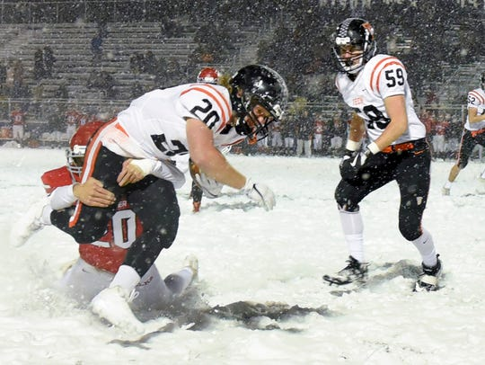 St. Cloud Tech's running back Scott Kippley is brought