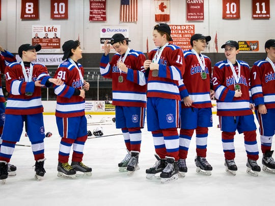 The New Jersey Colonials were given medals and hats to commemorate their 3-2 win over the Mid-Fairfield Jr. Rangers in the Silver Stick Finals PAAA Finals match at McMorran Arena Jan. 7.