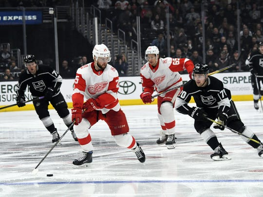 Red Wings defenseman Mike Green (25) handles the puck as Kings left wing Tanner Pearson (70) defends in the second period on Thursday, March  15, 2018, in Los Angeles.