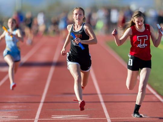 A Fernley High School runner finishes the Women's 4