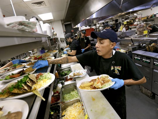L&J Cafe cook Steve Sanchez works in a busy kitchen in this 2018 photo. The popular Mexican restaurant is temporarily closed due to coronavirus-tied business restrictions.