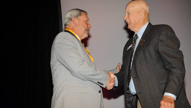 Former Humboldt and Chester County football coach and principal Jim Poteete congratulates former Dyersburg and Henry County coach Jim Counce Sr. on his induction into the TSSAA Hall of Fame last year. Poteete passed away Wednesday, and Counce died suddenly last fall.