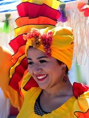 Alyna Allison, dressed as Carmen Miranda, poses for