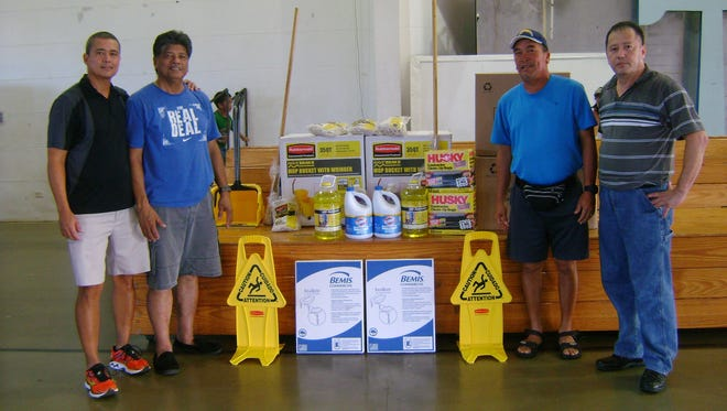 Island Sports Association donated cleaning equipment and supplies to the Yigo mayor and vice mayor for the Yigo gymnasium on July 19. Standing from left: Paul Alfred, president of Island Sports Association; Yigo Mayor Rudy Matanane; Yigo Vice Mayor Anthony Sanchez and Raffy Advincula, vice-president of Island Sports Association.