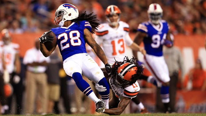 Aug 20, 2015; Cleveland, OH, USA; Buffalo Bills cornerback Ronald Darby (28) is tackled by Cleveland Browns wide receiver Travis Benjamin (11) at FirstEnergy Stadium. Mandatory Credit: Andrew Weber-USA TODAY Sports