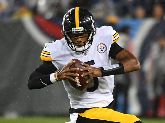Steelers quarterback Joshua Dobbs (5) avoids pressure during a preseason game against the Titans on Aug. 25. Pittsburgh traded Dobbs to Jacksonville on Monday in exchange for a 2020 fifth-round pick.
