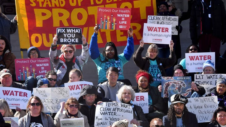 """Water Warriors"" gather at the foot of the steps to the Capitol in Lansing on Wednesday to take part in demonstrations on United Nations World Water Day. According to the UN, the day is held annually as a means of focusing attention on the importance of freshwater."