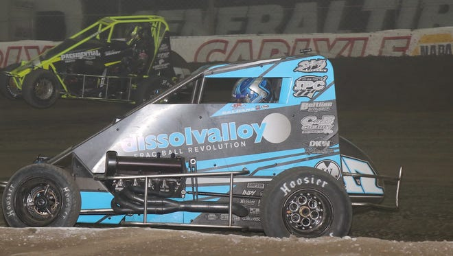 Alex Bright, on the outside, beat Joey Saldana, in the near car, to the checkered flag during the Chili Bowl race Tuesday.