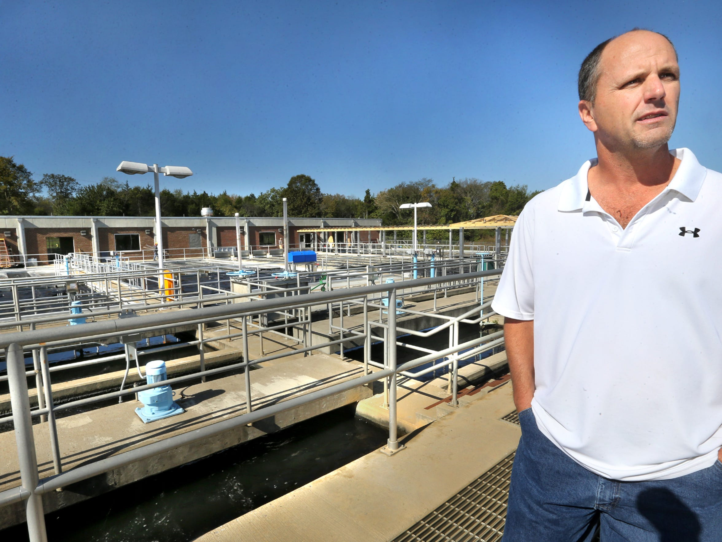 Chris Forte, manager of the K. Thomas Hutchinson Water Treatment Plant in Rutherford County stands in front of the mixing and the sedimentation tanks, on Tuesday, Oct. 13, 2015, where water from the East Fork of the Stones River is pumped.