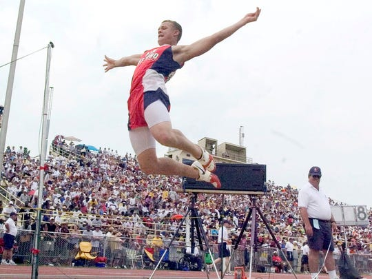 New Oxford's Erik Harris takes flight during his second attempt in the long jump at the PIAA Track and Field Championships at Shippensburg University in 2007.