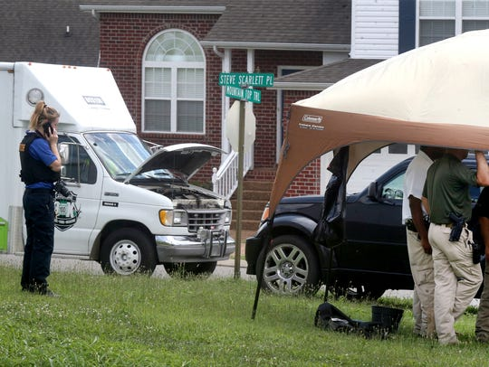 Emergency personnel work a shooting crime scene along