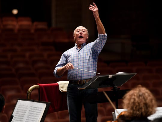 Edvard Tchivzhel, the conductor of the Greenville Symphony, leads a rehearsal on Wednesday.