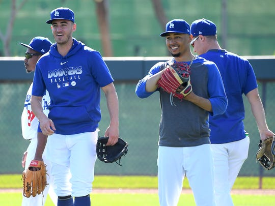 Feb 20, 2020; Glendale, Arizona, USA;  Los Angeles Dodgers center fielder Cody Bellinger (35) and right fielder Mookie Betts (50) take fly ball drills during during spring training at Camelback Ranch. Photo Credit: Jayne Kamin-Oncea - USA TODAY Sports