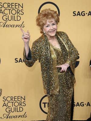 Debbie Reynolds poses in the photo room of the 20th Screen Actors Guild Awards held at the Shrine Auditorium in Los Angeles.