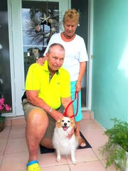 Jack and Linda Addy with their dog Barney are at the front door of their home on the Isles of Capri