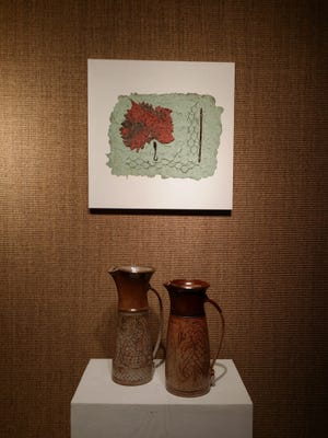 Sycamore Leaf on Green, Barbara Rodenberg, mixed media (above) and Pitcher and Dragon Pitcher, David Rodenberg, both high fire stoneware