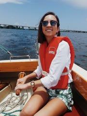 Olivia Hoyos learning to sail a boat.