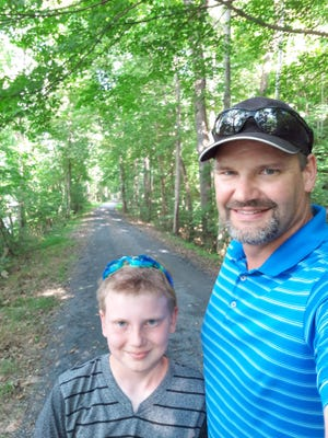 Jeremy Knowlton of Heathsville, Va., found John W. Thomas Jr.'s class ring in the Conococheague Creek while 'adventuring' with his son, Shrade. PROVIDED PHOTOS