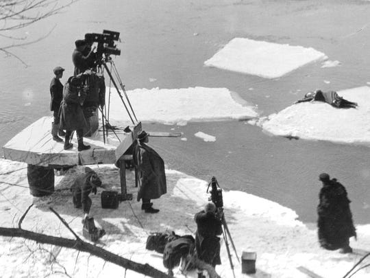 D. W. Griffith filming 1920's Way Down East with Lillian Gish on ice where the cold injured her hand.
