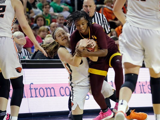 Arizona State's Charnea Johnson-Chapman, right, grabs at the ball held by Oregon State's Mikayla Pivec for a jump ball, giving Arizona State possession late in the second half of an NCAA college basketball game in the quarterfinals of the Pac-12 women's tournament Friday, March 2, 2018, in Seattle. Arizona State won 57-51. (AP Photo/Elaine Thompson)
