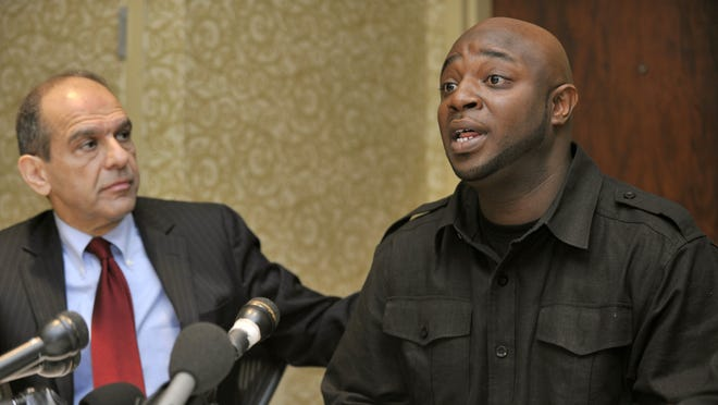 FILE - In this Monday, Dec. 5, 2011 file photo, Charles Crawford, right, speaks accompanied by attorney Mitchell Garabedian during a news conference in Boston. Crawford is one of the men accusing Donald Fitzpatrick, a former Boston Red Sox clubhouse manager, of sexually abusing them when they were youths. Fitzpatrick died in 2005.