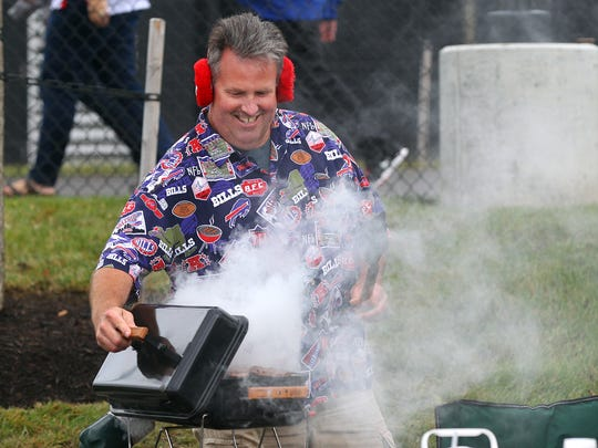 Paul Strain of Canandaigua checks his grill before the Bills take on the Colts.