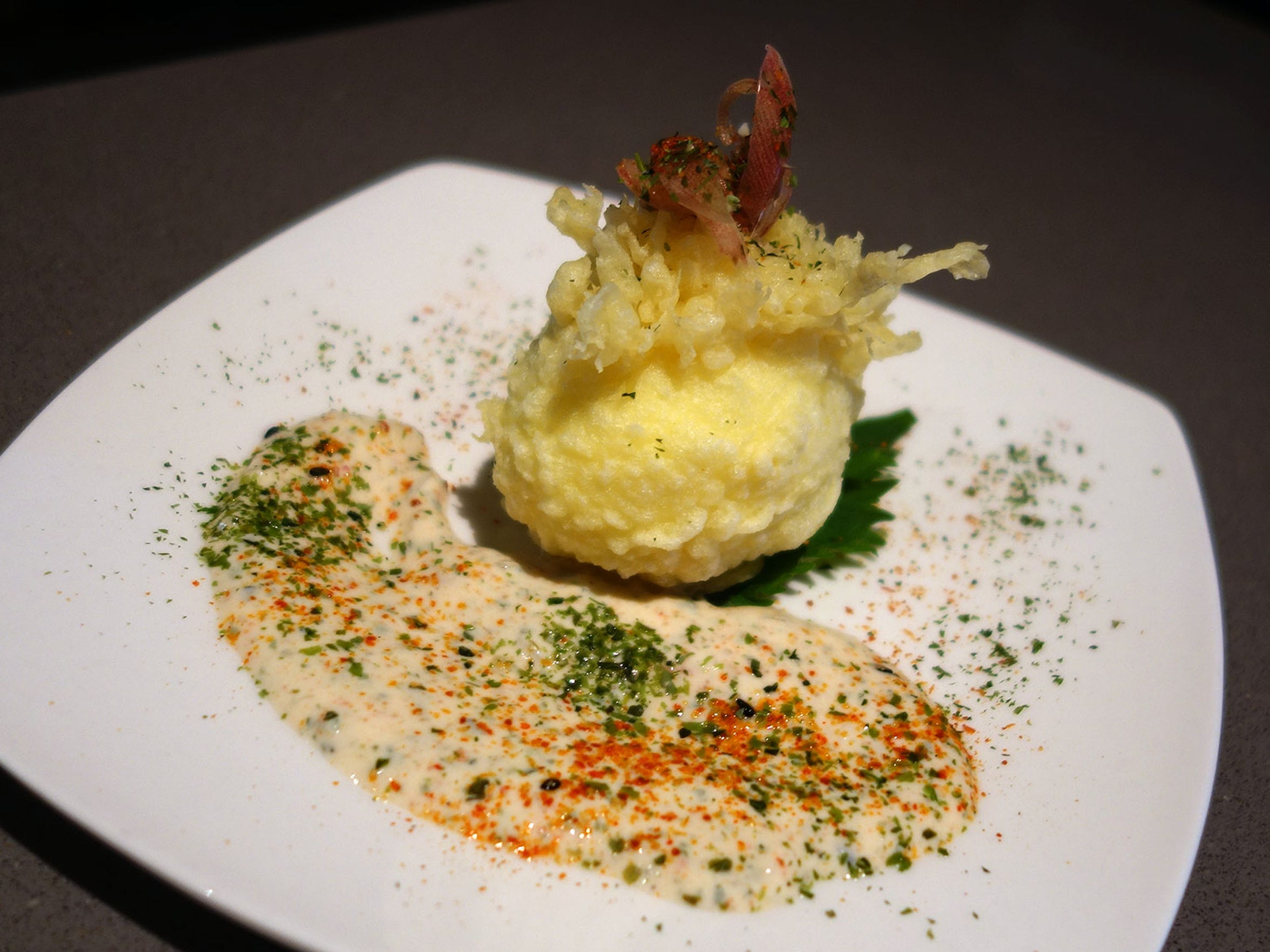 The Hana egg, a tempura-fried poached egg, plated with