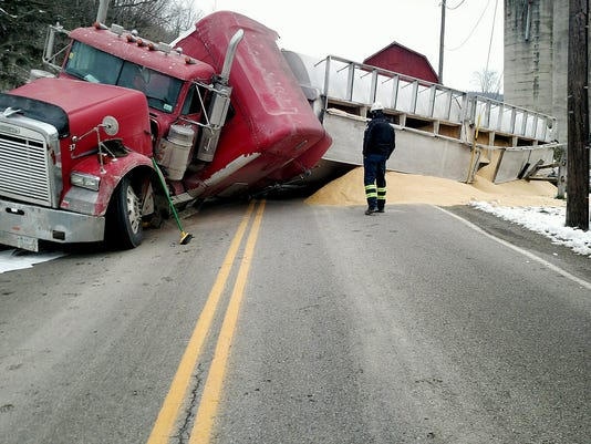 Rolled-over truck creates MESS of grain, fuel