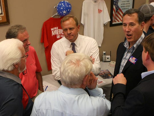 (Clockwise from top) U.S. Rep. Stephen Fincher, former U.S. Senator Rick Santorum, 8th congressional candidate Brian Kelsey, State Rep. Jimmy Eldridge, Madison County Commission Chairman Gary Deaton and Madison County Mayor Jimmy Harris talk at the Madison County Republican Party headquarters in Jackson, Tenn., on Tuesday, Aug. 2, 2016.